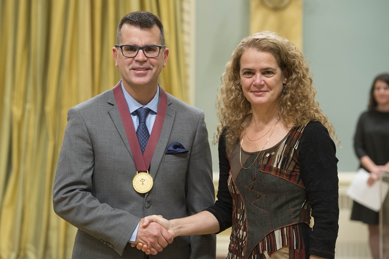 Rob Flosman shakes hands with the Governor General Julie Payette